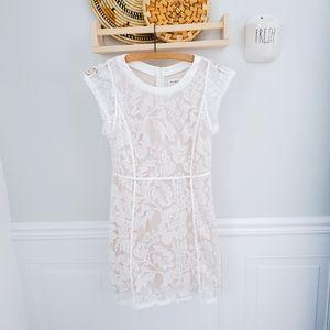 Striking sheer overlay dress